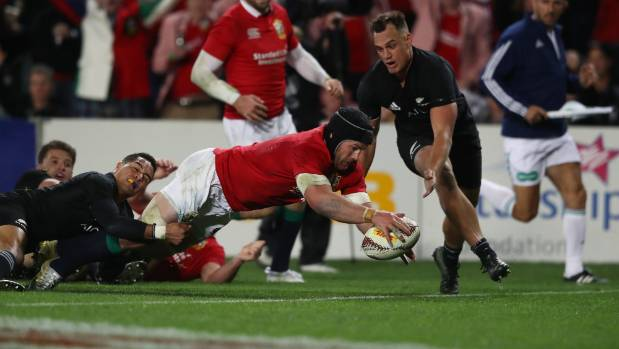 Sean O'Brien of the Lions dives over to score his team's first try.