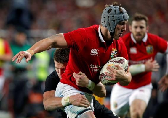 Beauden Barrett tackles the Lions' Jonathan Davies.