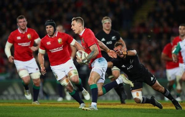 The Lions' Liam Williams makes a break for it.
