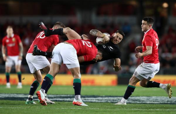 Sonny Bill Williams is tackled by the Lions.