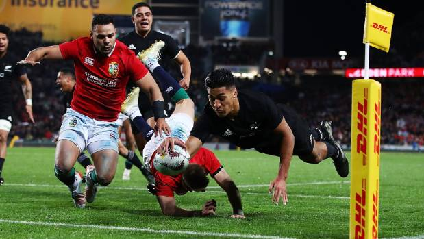 Rieko Ioane scores a try in the corner against the Lions.