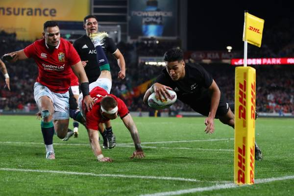 AUCKLAND, NEW ZEALAND - JUNE 24:  Rieko Ioane of the All Blacks dives over to score his team's second try during the ...