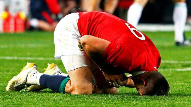 Halfback Conor Murray reels after a collision with an All Blacks defender at Eden Park.