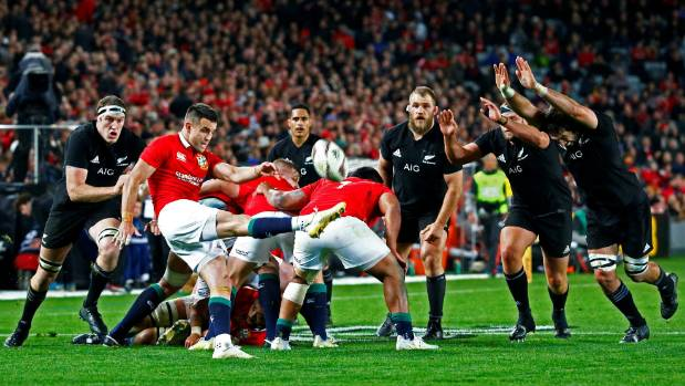 Lions halfback Conor Murray kicks under close attention from the All Blacks in Auckland.