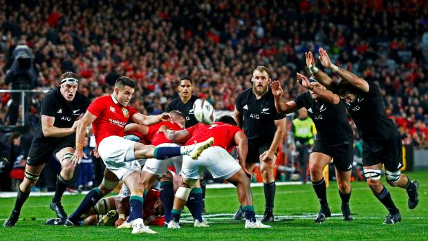 Lions halfback Conor Murray under close attention from the All Blacks during the first test.