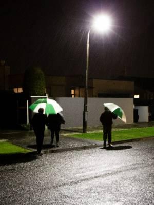 Martin St residents gather under an LED light pool. From left: Jim Frecklington, Midge Janssen, Shelley Rohe and Henk ...