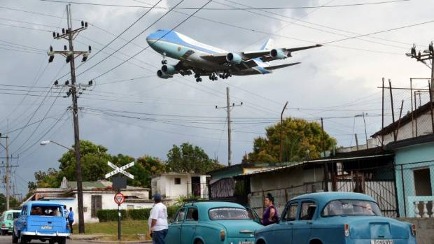 The Boeing 747 Air Force One carrying US President Barack Obama and his family flies over a neighborhood of Havana.