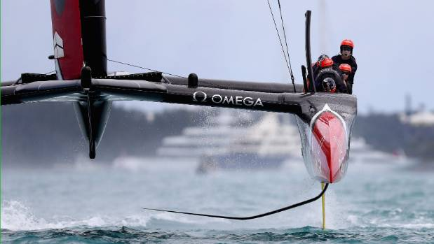 Emirates Team New Zealand helmed by Peter Burling in action racing against Oracle Team USA skippered by Jimmy SpithilL.