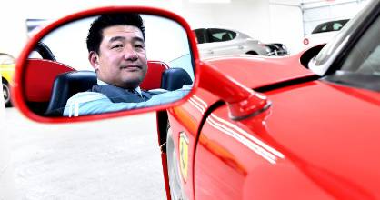 Timepiece and jewellery entrepreneur David Lee poses with his Ferrari collection in Walnut, California.