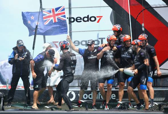 Champagne celebrations for Team NZ.