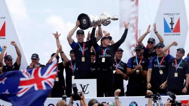 Emirates Team New Zealand helmsman Peter Burling celebrates with skipper Glenn Ashby after defeating Oracle Team USA in ...
