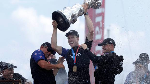 Team NZ helmsman Peter Burling celebrates with the America's Cup.