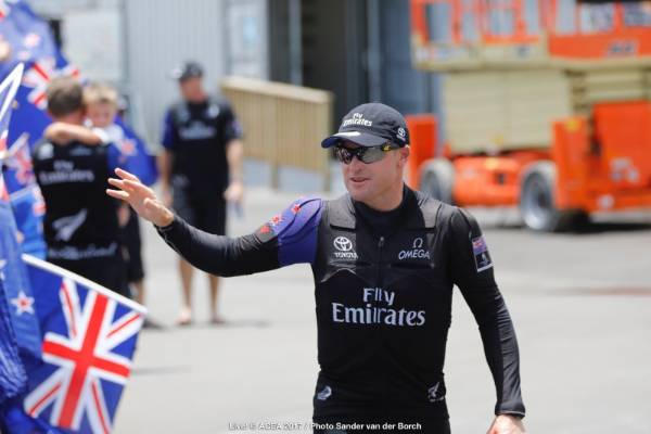 Team NZ skipper Glenn Ashby waves to fans as he heads for the boat ahead of race nine in the America's Cup final.