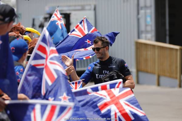 Team NZ's Blair Tuke meets fans as he heads to the boat ahead of race nine in the America's Cup final.