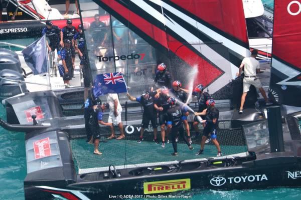 Team NZ celebrate winning the America's Cup.