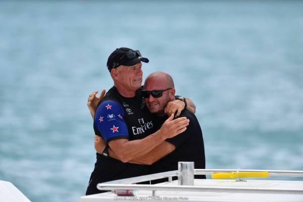 Team NZ boss Grant Dalton grabs a celebratory hug after winning back the Auld Mug.