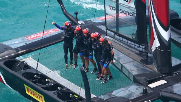 The Emirates Team New Zealand crew celebrate winning the America's Cup.
