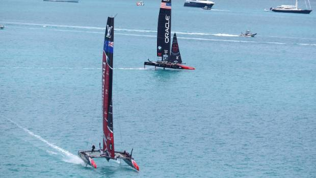 Team New Zealand sail away from Oracle on the way to winning the America's Cup.