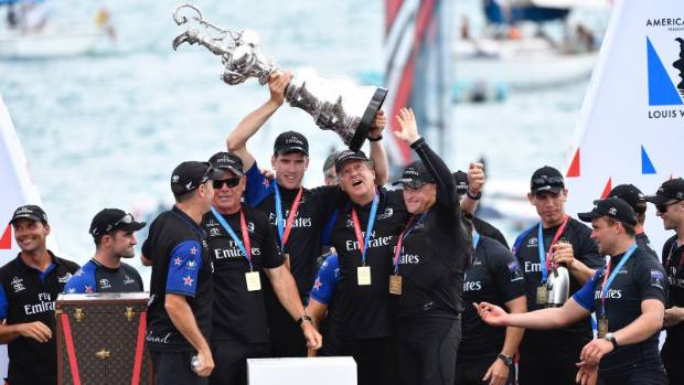 Peter Burling lifts the Auld Mug after leading Team New Zealand to victory in the 35th America's Cup.