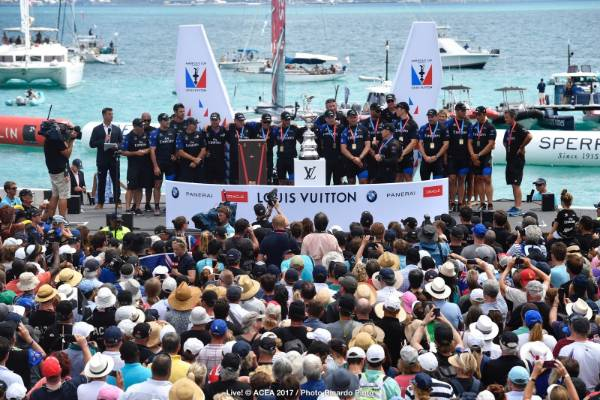 Team NZ stand at the podium poised to receive the Auld Mug.
