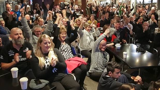 Yachting fans celebrate the America's Cup win at the Royal Port Nicholson Yacht Club in Wellington.