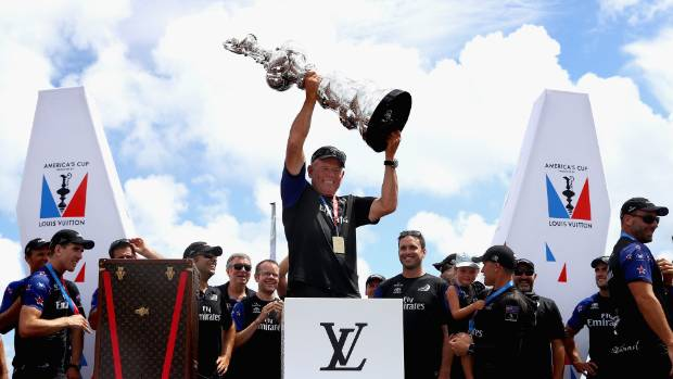Grant Dalton lifts the cup after Team New Zealand win race 9 against Oracle in Bermuda this week.