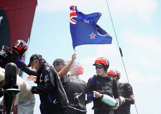 Peter Burling and the rest of the Team New Zealand crew celebrate their victory.