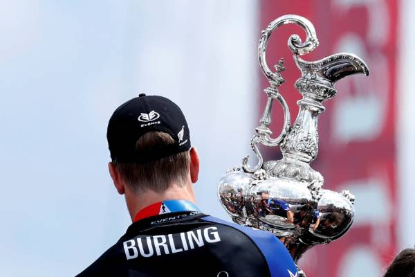 Peter Burling, Emirates Team New Zealand Helmsman holds the America's Cup after defeating Oracle Team USA.