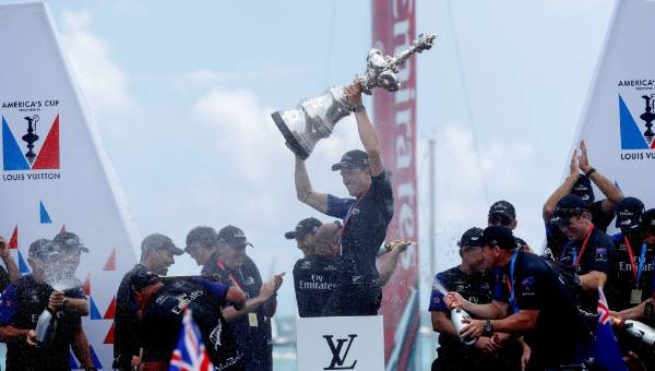 Peter Burling holds up the America's Cup after defeating Oracle Team USA.