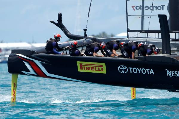 Team New Zealand leads Oracle Team USA around race course on the way to winning race nine and the America's Cup.