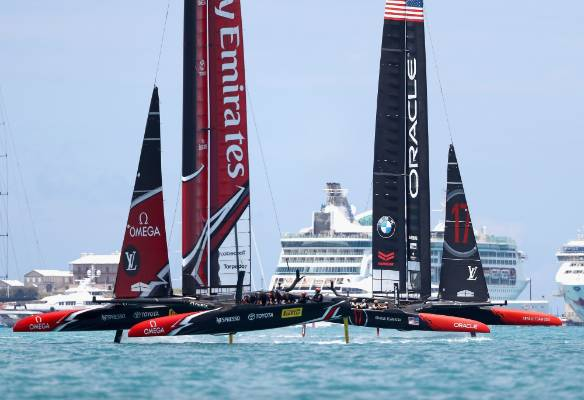Emirates Team New Zealand helmed by Peter Burling in action racing during race 9 against Oracle Team USA skippered by ...
