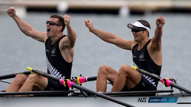 Joe Sullivan, left, and New Zealand's Nathan Cohen come in first place in the final of the men's double skulls during ...