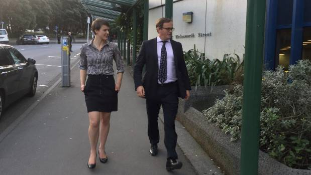 Thomson and lawyer Davey Salmon arrive at the High Court in Wellington for the second day of proceedings.