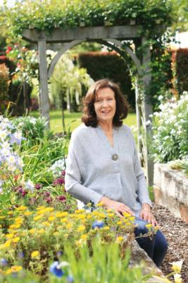 Anne Dotchin in front of her favourite part, the Secret Garden.