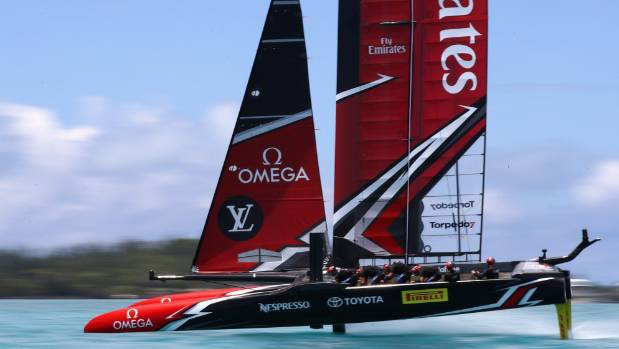 Emirates Team New Zealand roars across the water towards victory in the 35th America's Cup regatta off Bermuda.