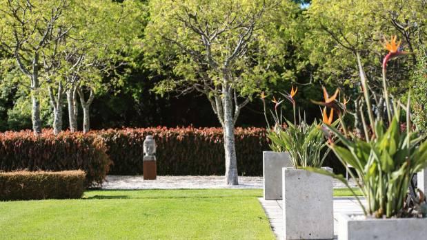 Potted bird of paradise (Strelitzia reginae) surround the northern terrace.