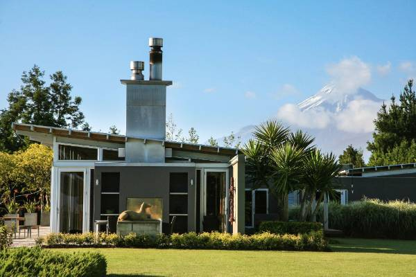 Mt Taranaki rises dramatically to the south of the Paul Francis-designed house, which also has expansive views of New ...