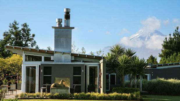 Mt Taranaki rises dramatically to the south of the house, which also has expansive views of New Plymouth and the sea beyond.