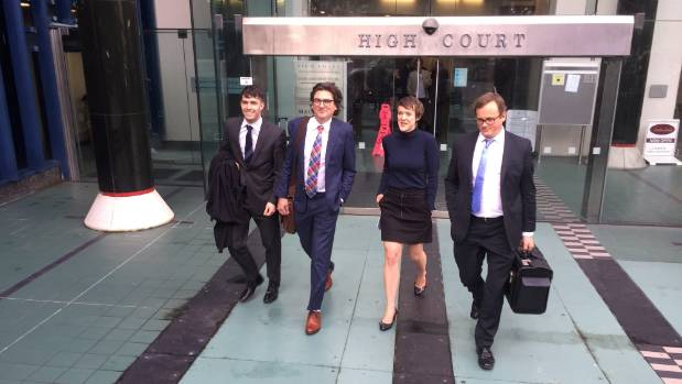 Sarah Thomson leaves the High Court at Wellington for the last time with legal team Sam Humphrey, Michael Heard, and ...
