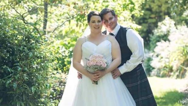 Cam And Laura Share A Special Moment In The Garden On Their Wedding Day