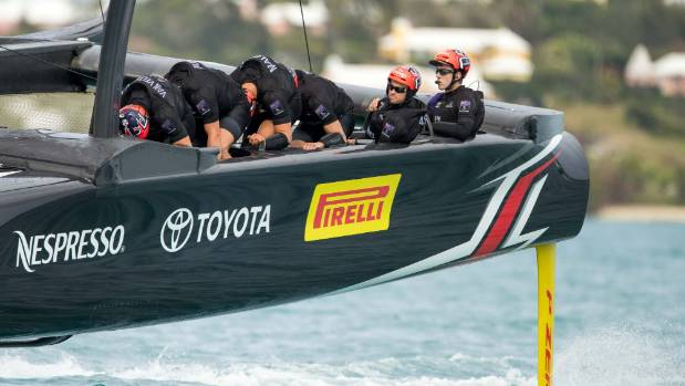 Skipper Glenn Ashby and helmsman Peter Burling enjoy the ride on Team New Zealand's cycle-powered AC50 in Bermuda.