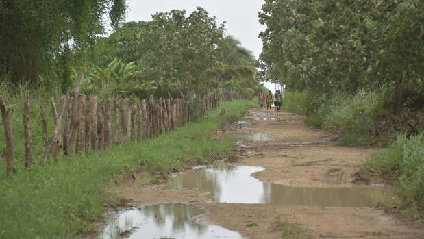 The wet dirt road leading to the children's home.