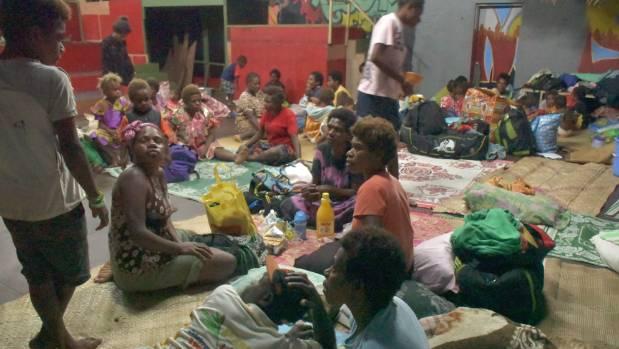 Families shelter inside the Wan Smol BagYutSenta in Vanuatu's capital Port Vila ahead of Cyclone Donna.