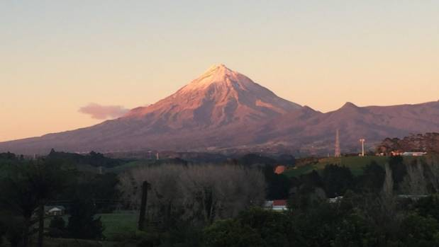 Officials were waiting for daylight to break on Mt Taranaki before airlifting the man's body off.