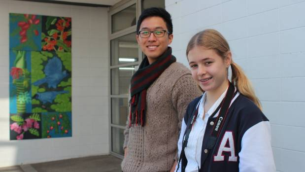 Photography teacher William Kim, left, encouraged Jade to enter the competition.