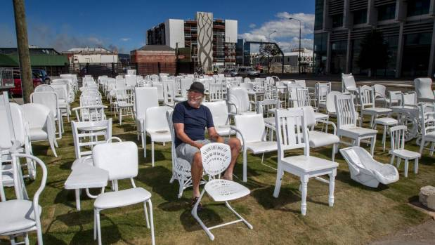 Peter Majendie sits within the 185 chairs that have become a fixture of post-earthquake Christchurch.
