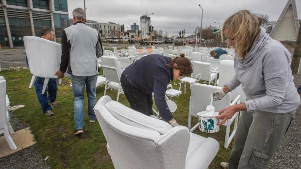 Volunteers help spruce up the chairs during a working bee in 2016.