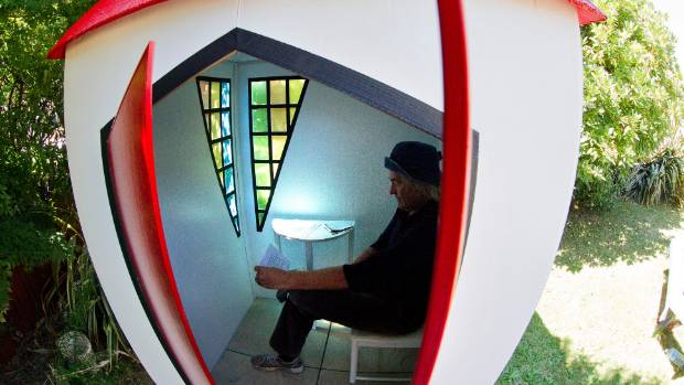 """Peter Majendie inside one of the """"God boxes"""" that he installed for private contemplation in Christchurch in 2013."""