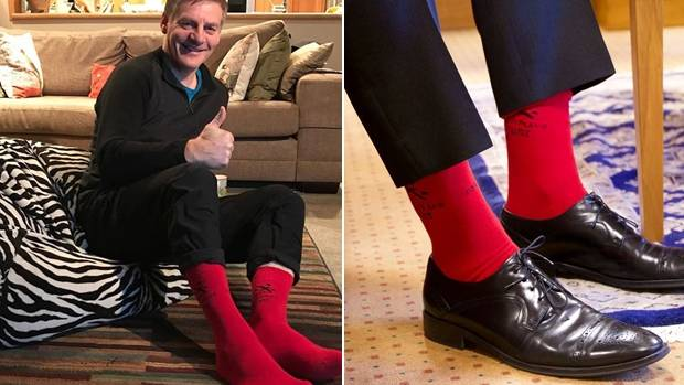 Bill English's smiling America's Cup photo quickly had 3000 likes. Andrew Little's red socks, just 418 likes.