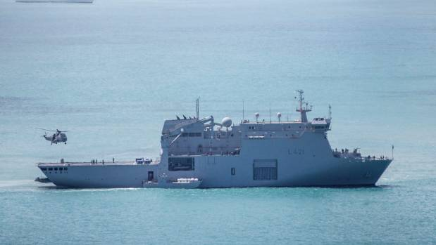 Military helicopters transport supplies from the HMNZS Canterbury.